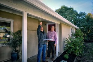 Glenn Allen working with a home inspector prior to selling home in The San Francisco East Bay